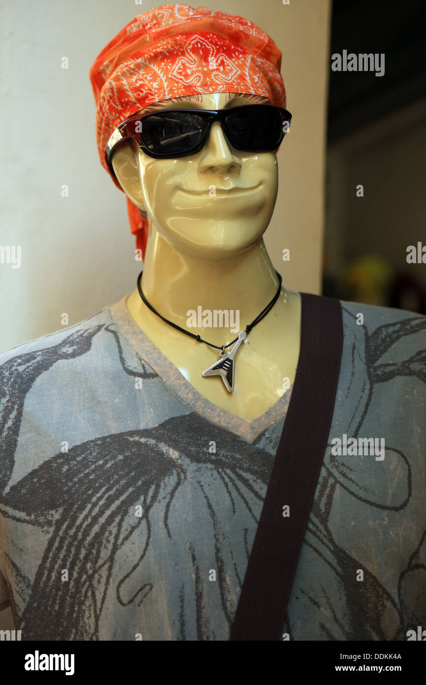 Clothing mannequin outside a clothes retailer shop in Greece - Stock Image