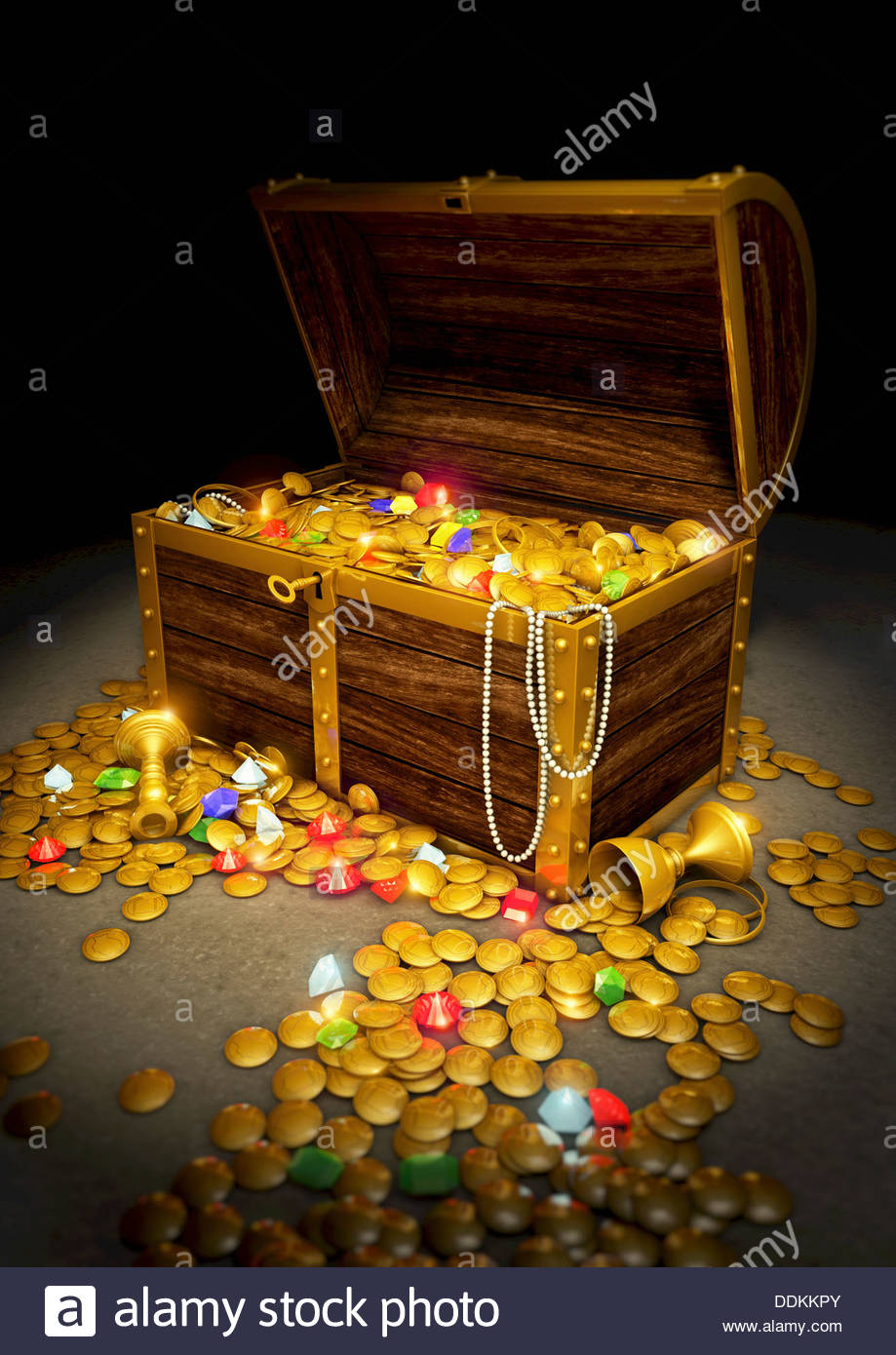 Gold coins and jewels spilling from treasure chest - Stock Image