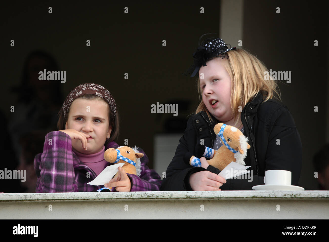 Young racegoers look on horse races during the 122nd Velka Pardubicka Steeplechase in Pardubice, East Bohemia, Czech Stock Photo