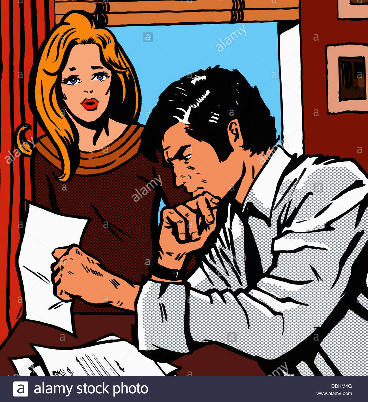 Worried couple looking at bills - Stock Image