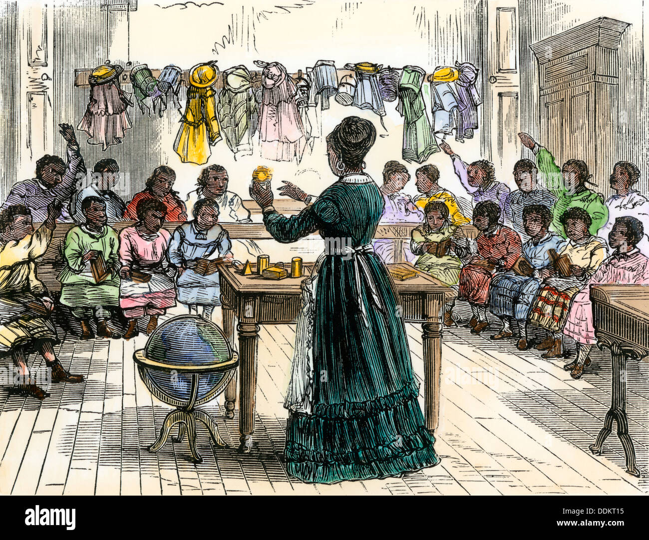 "Teaching objects to children in a ""colored school,"" New York City, 1870. Hand-colored woodcut Stock Photo"