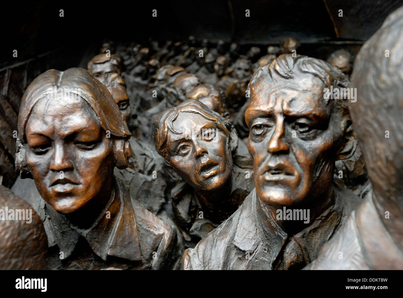 London, England, UK. St Pancras Railway Station. Detail from plinth at base of 9m high sculpture 'The Meeting Place' (Paul Day) - Stock Image