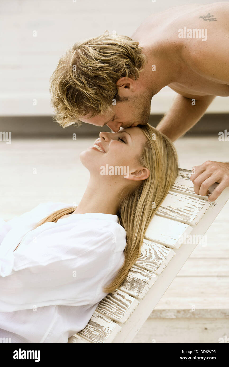 Man kissing tenderly a woman on her forehead Stock Photo