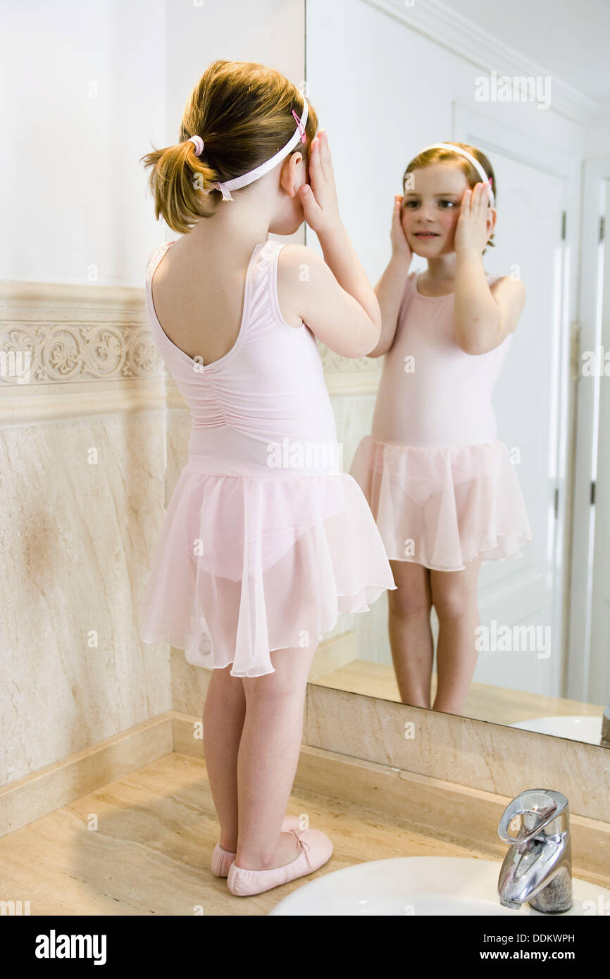 Little Girl In Ballet Dress Looking Herself At The Mirror