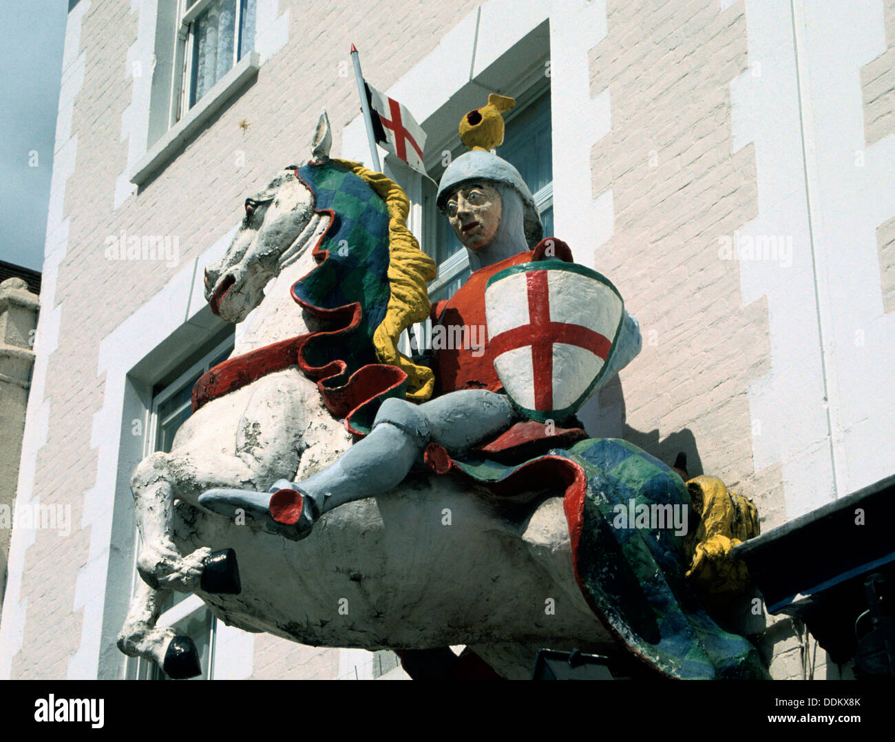 Figure outside a public house depicting St George on a horse. Artist: S Nott - Stock Image