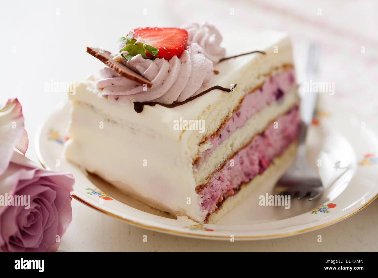 slice of layered cake - Stock Image