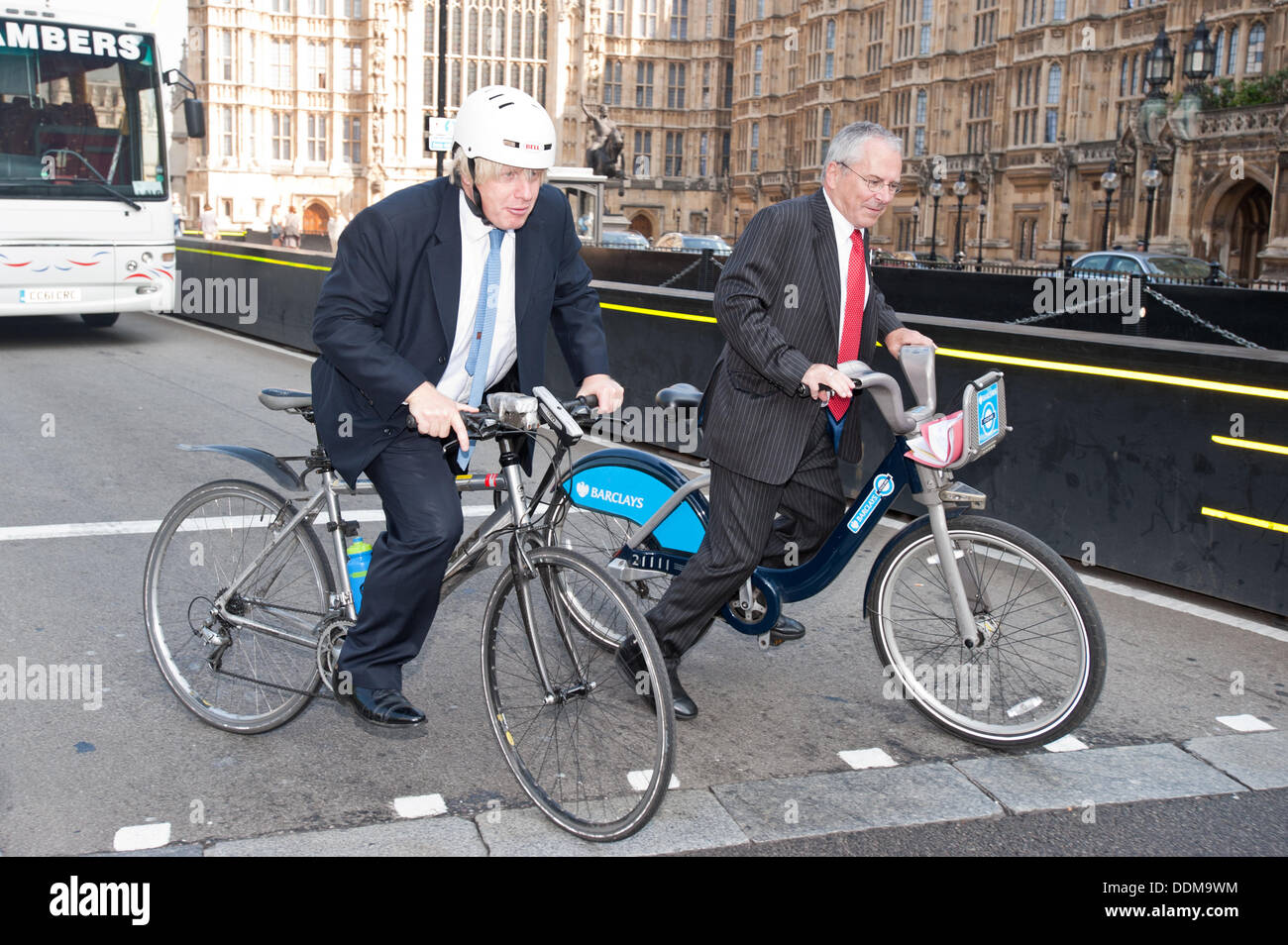 London, UK - 4 September 2013: the Mayor of London Boris Johnson and the London's Transport Commissioner, Sir Peter Hendy, ride their bikes in Westminster after unveiling a number of measures to tackle Heavy Goods Vehicle (HGV) safety as part of a joint effort to boost cycling in the capital. Credit:  Piero Cruciatti/Alamy Live News - Stock Image