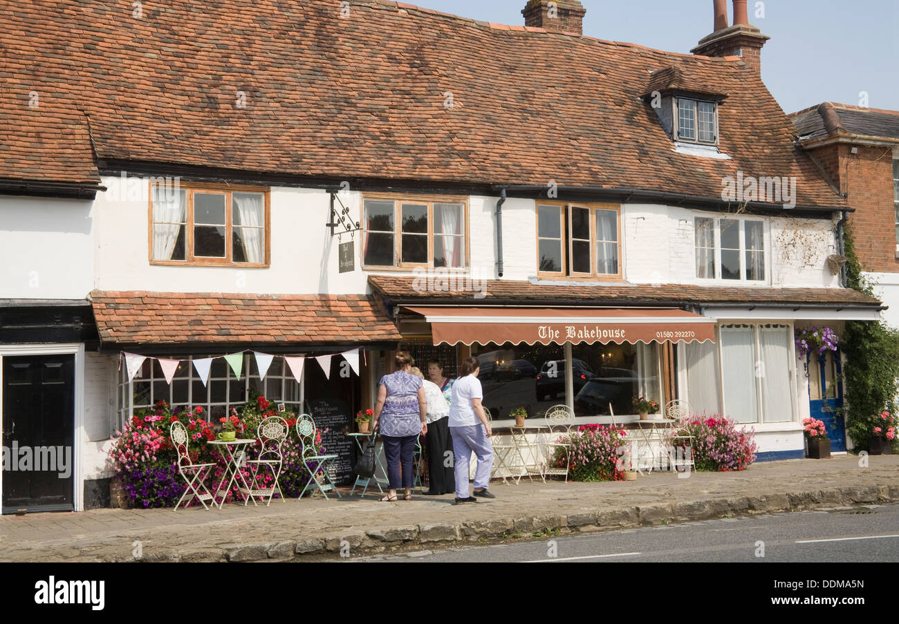 Biddenden Kent England UK Customers outside The Bakehouse cafe on the main street - Stock Image