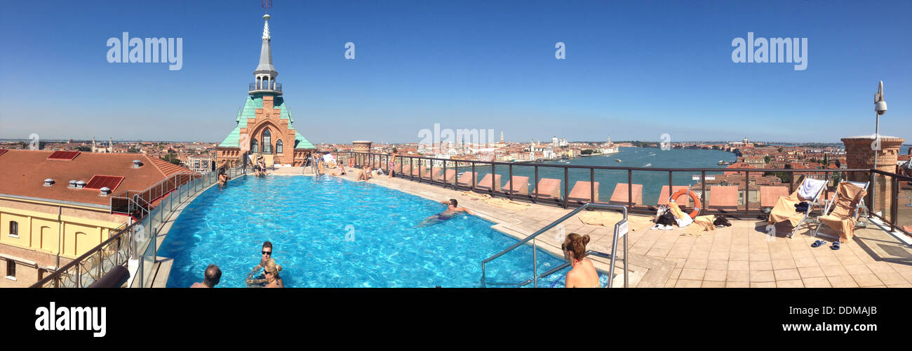 Rooftop pool overlooking Venice at Hilton Molino Stucky Hotel, Italy August 2013 - Stock Image