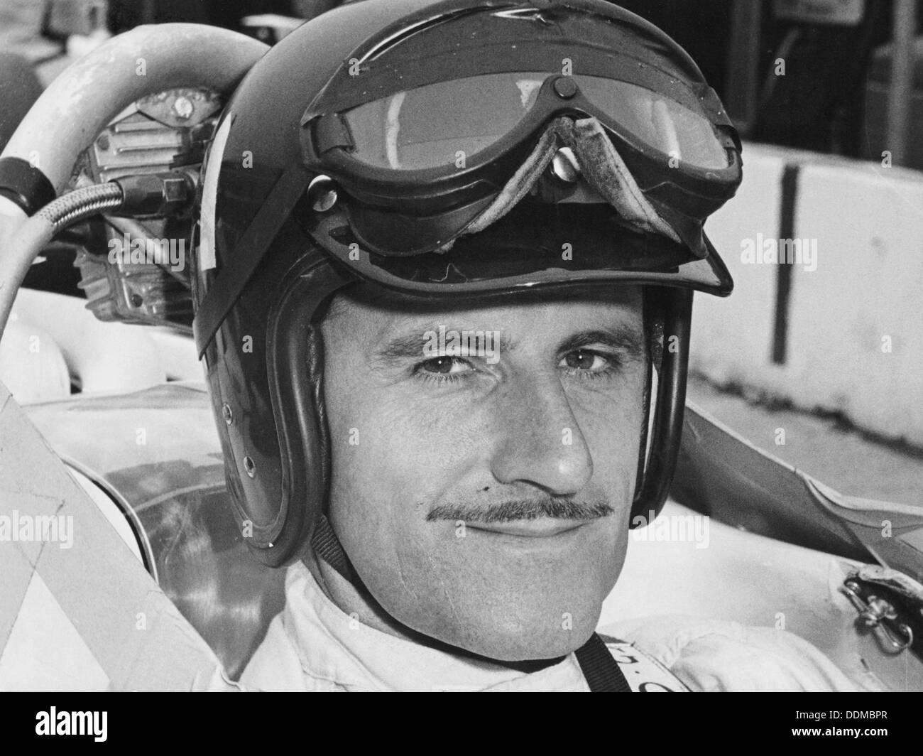 Graham Hill in cockpit of Lola T90, Indianapolis, 1966. - Stock Image