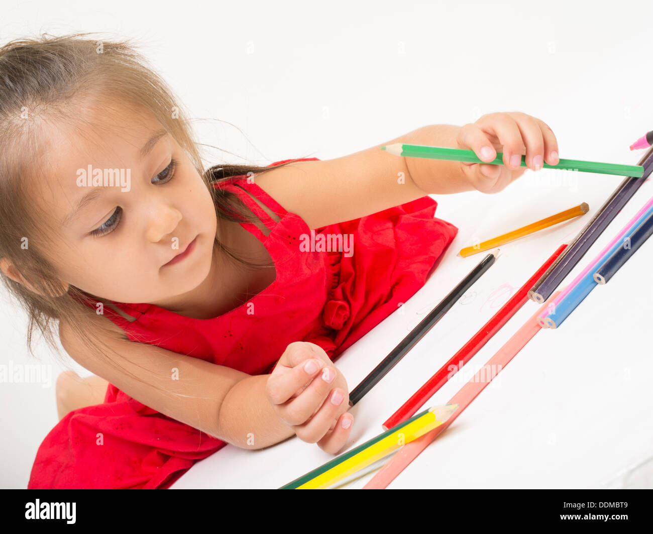 Young girl coloring with colored pencils Stock Photo: 60069977 - Alamy