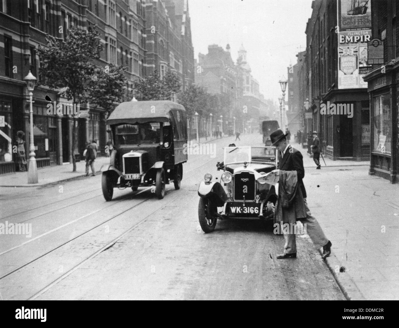 A Rover 1928 10/25 HP sports car parked in a London street, 1931. - Stock Image