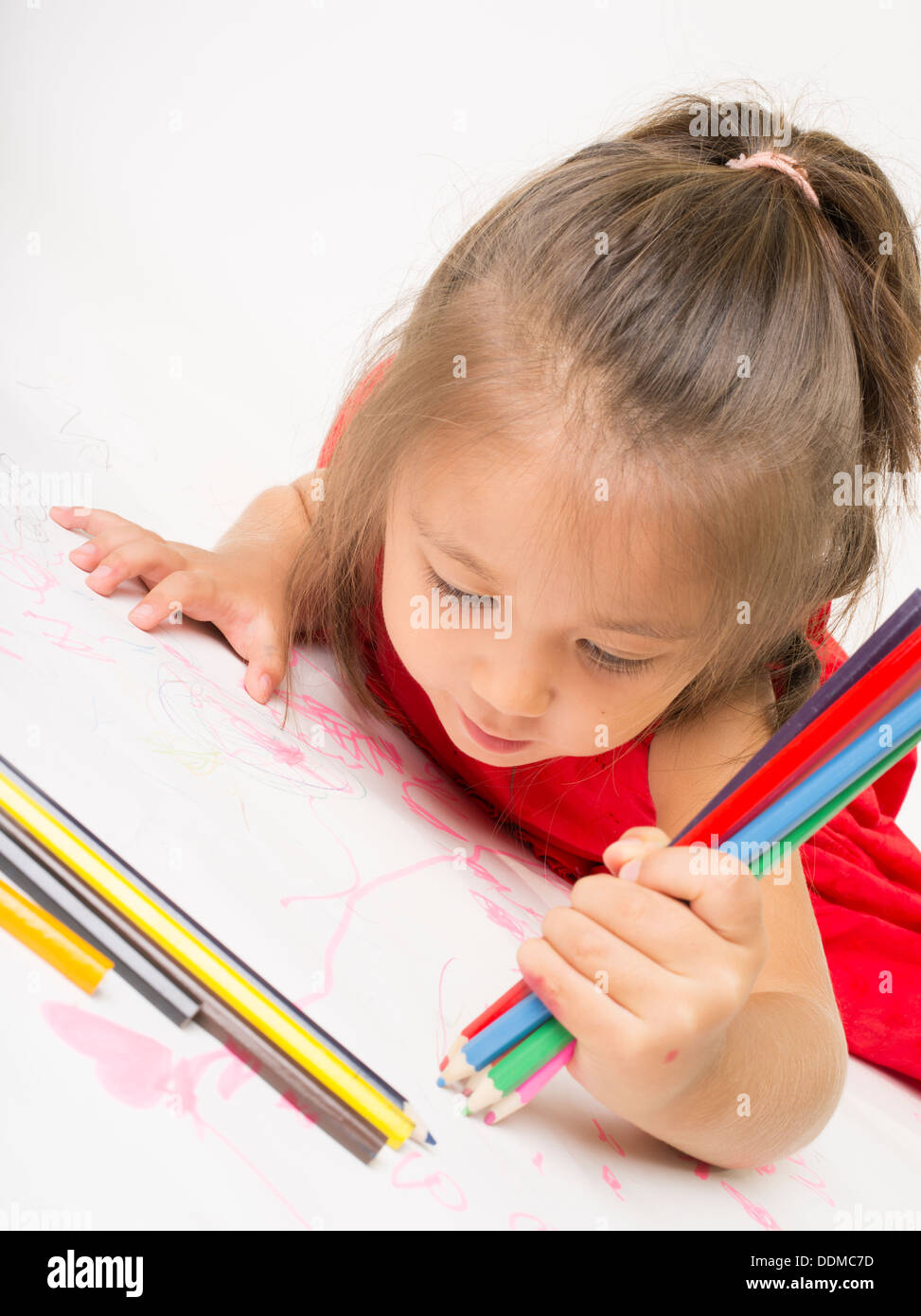 Young girl coloring with colored pencils Stock Photo: 60070289 - Alamy