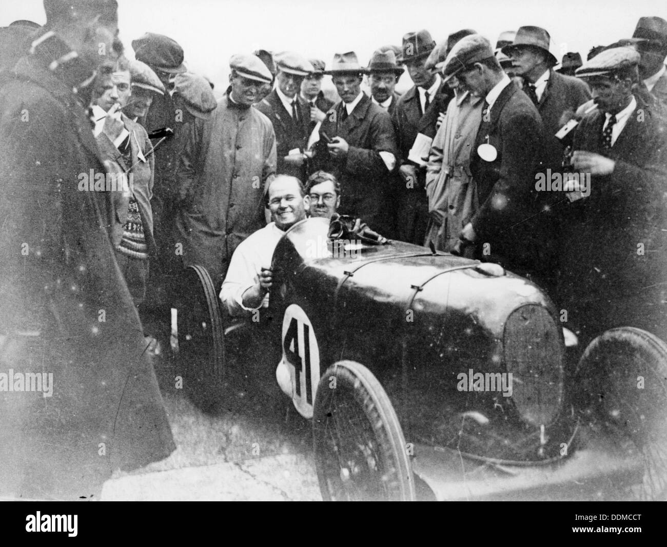 Gordon Taylor in a racing car surrounded by a crowd of men. - Stock Image