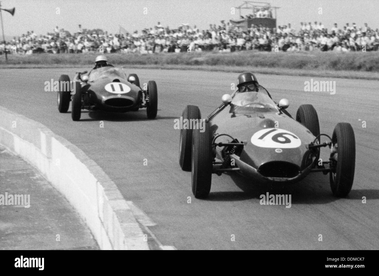 Graham Hill and Jack Brabham racing in the XI British Grand Prix, Silverstone, July 1958. - Stock Image