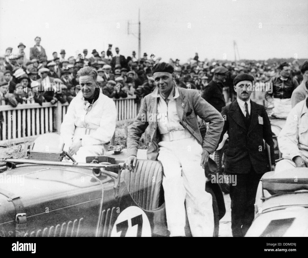 FS Barnes in the centre, AH Langley to his right, with a Singer Nine Sports car, 1930s. - Stock Image