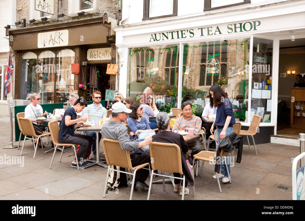Aunties Tea Shop, with people drinking and sitting outside in summer, St Marys Passage, Cambridge city centre,  UK - Stock Image