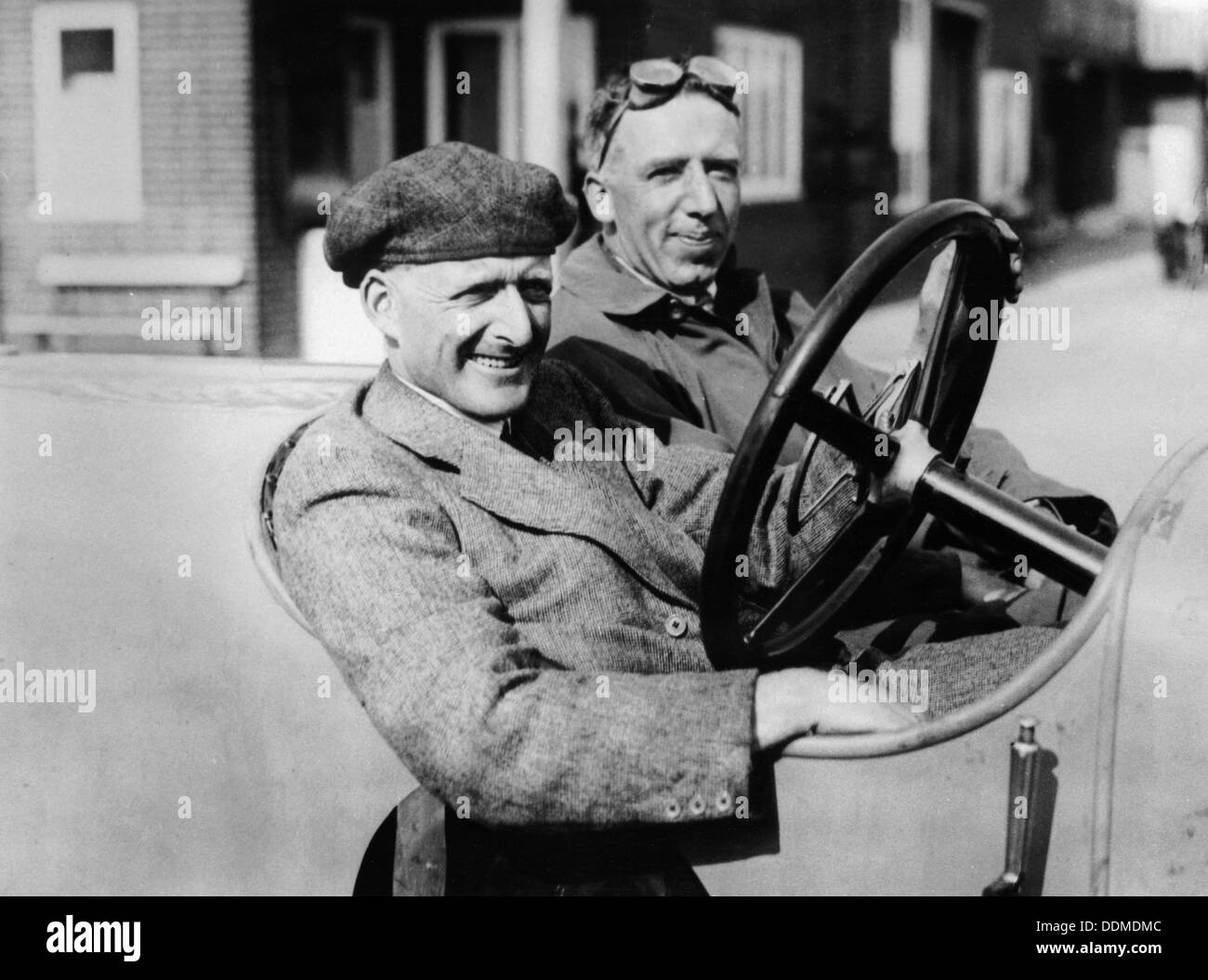 Two men in a vintage car. - Stock Image
