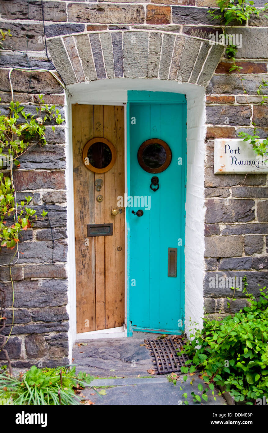 Unusually narrow slanting front doors on cottages in Boscastle Cornwall England UK & Unusually narrow slanting front doors on cottages in Boscastle Stock ...