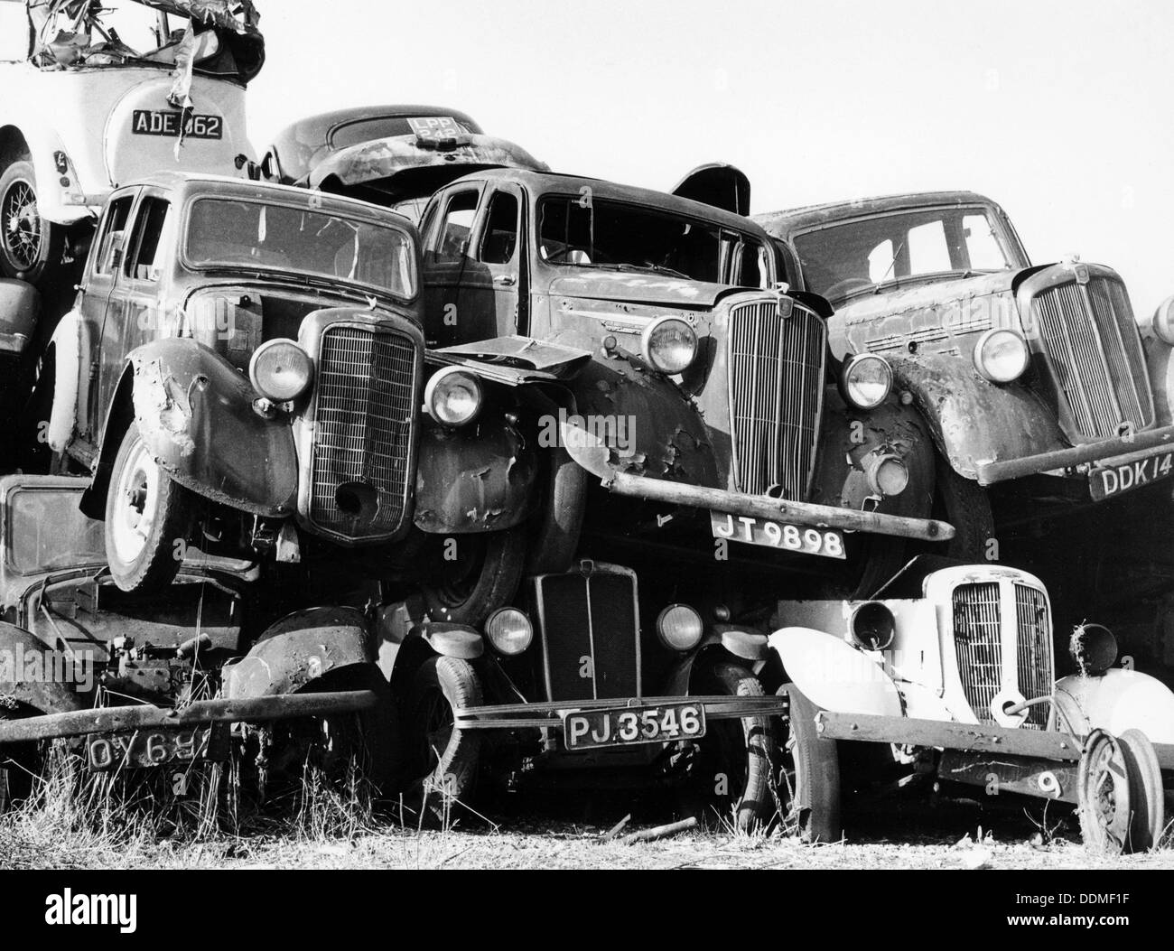 Old cars piled up in a scrapyard, Britain Stock Photo: 60072475 - Alamy