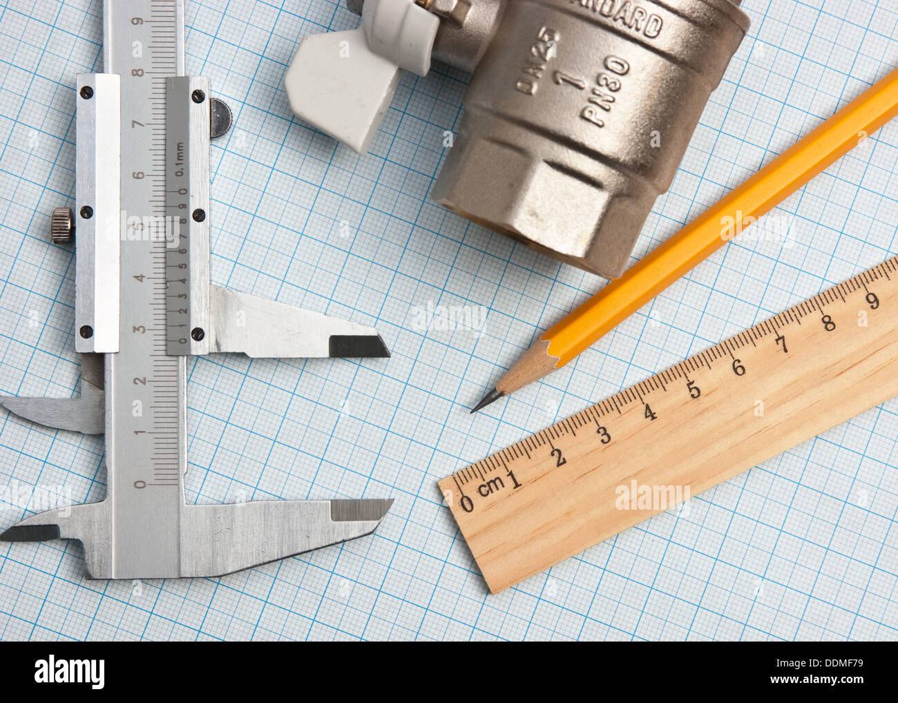 Water Inlet Valve On A Background Of Graph Paper Stock Photo