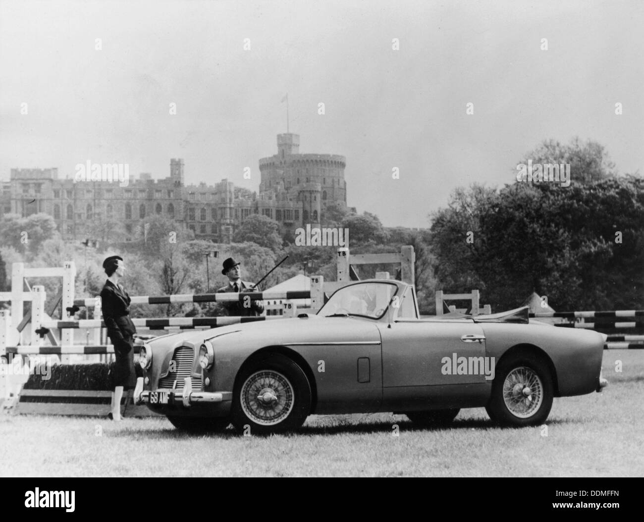 An Aston Martin DB2-4 MKII, with Windsor Castle in the background, 1956. - Stock Image