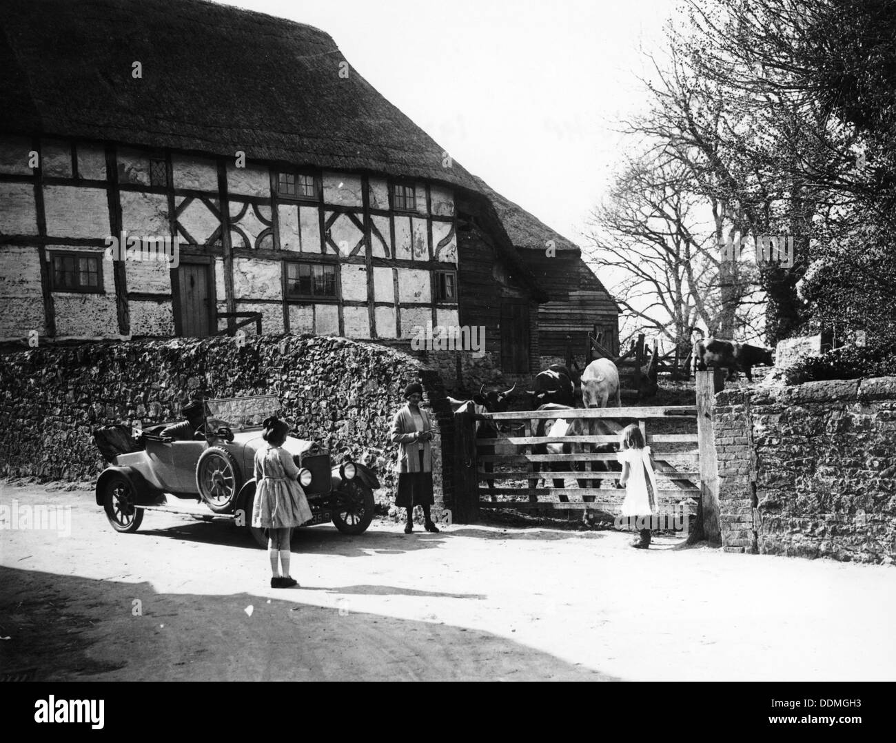 Calcott 2-seater car parked outside a farm gate, c1921-c1922. - Stock Image