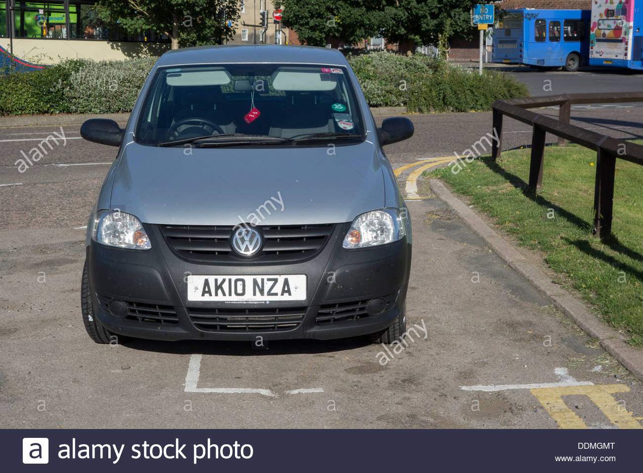 Car badly parked outside the parking bay - Stock Image