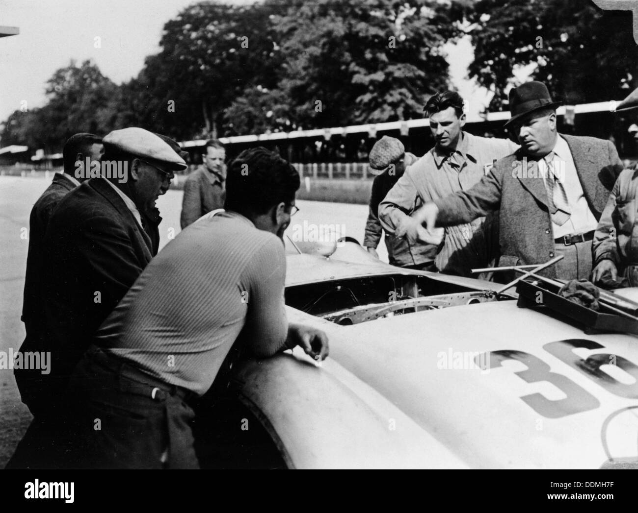 Alfred Neubauer with a Mercedes, Avus motor racing circuit, Berlin, Germany, 1938. - Stock Image