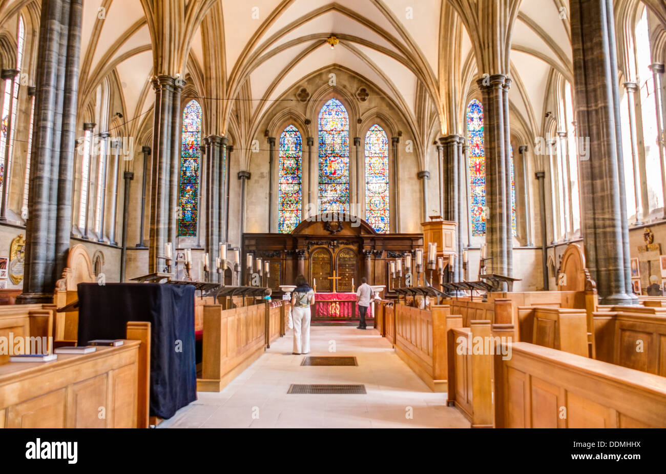 Inside the Holy trinity Temple Church in London looking towards the main, stain glass windows - Stock Image