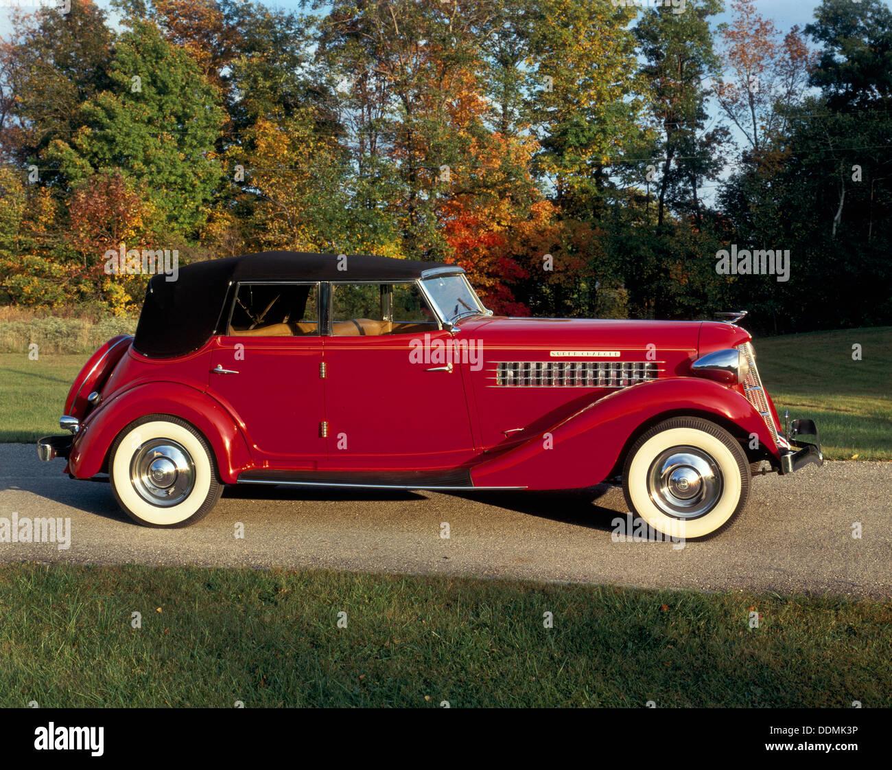 A 1936 Auburn 852 Car On A Gravel Driveway In The Autumn