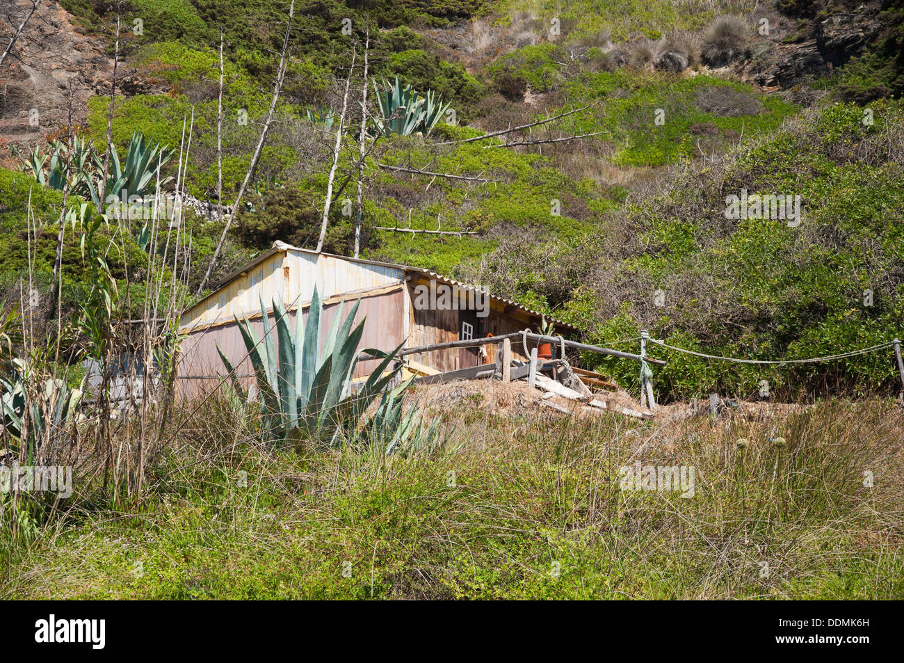 House in the middle of the scarp - Stock Image