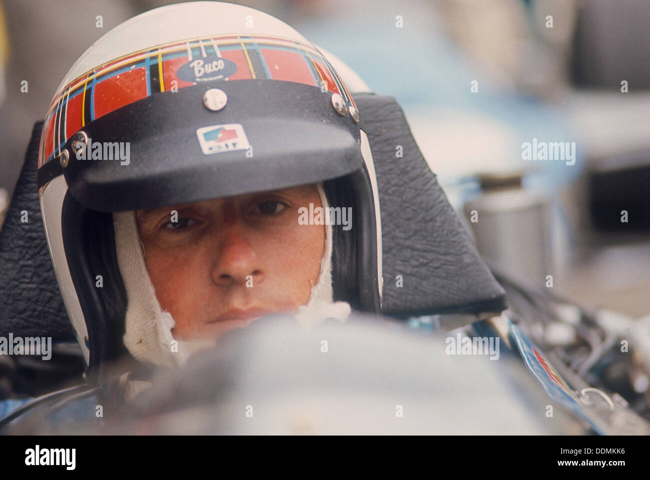 Jackie Stewart at the wheel of a racing car. - Stock Image