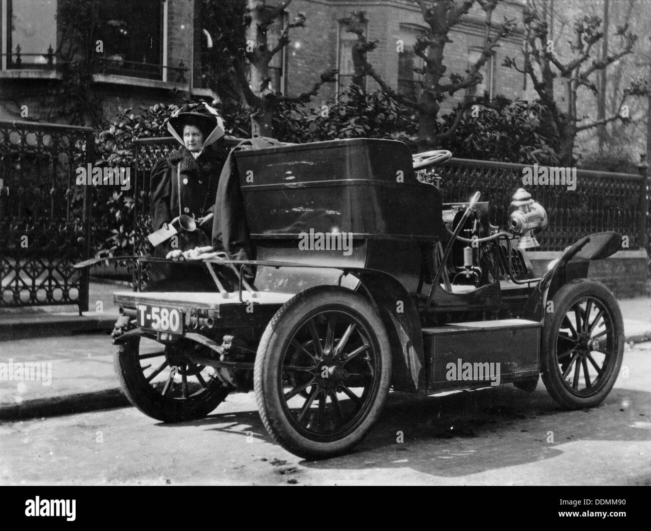 A 1904 De Dion car parked in a street, (c1904?). - Stock Image