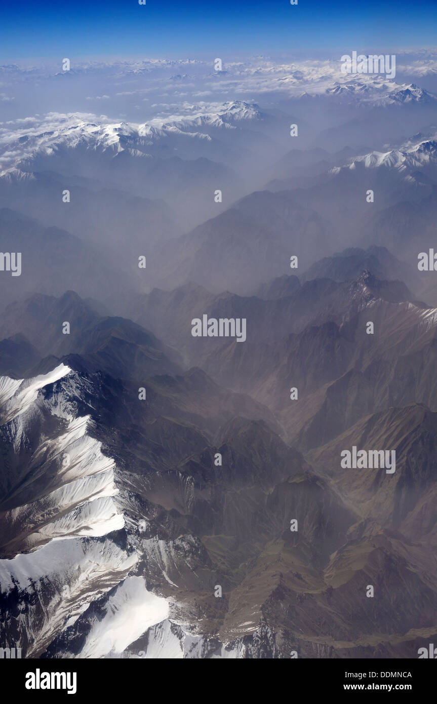 aerial view of Karakoram mountains of Sinkiang, China, you can see frozen peaks and deep valley.  - Stock Image