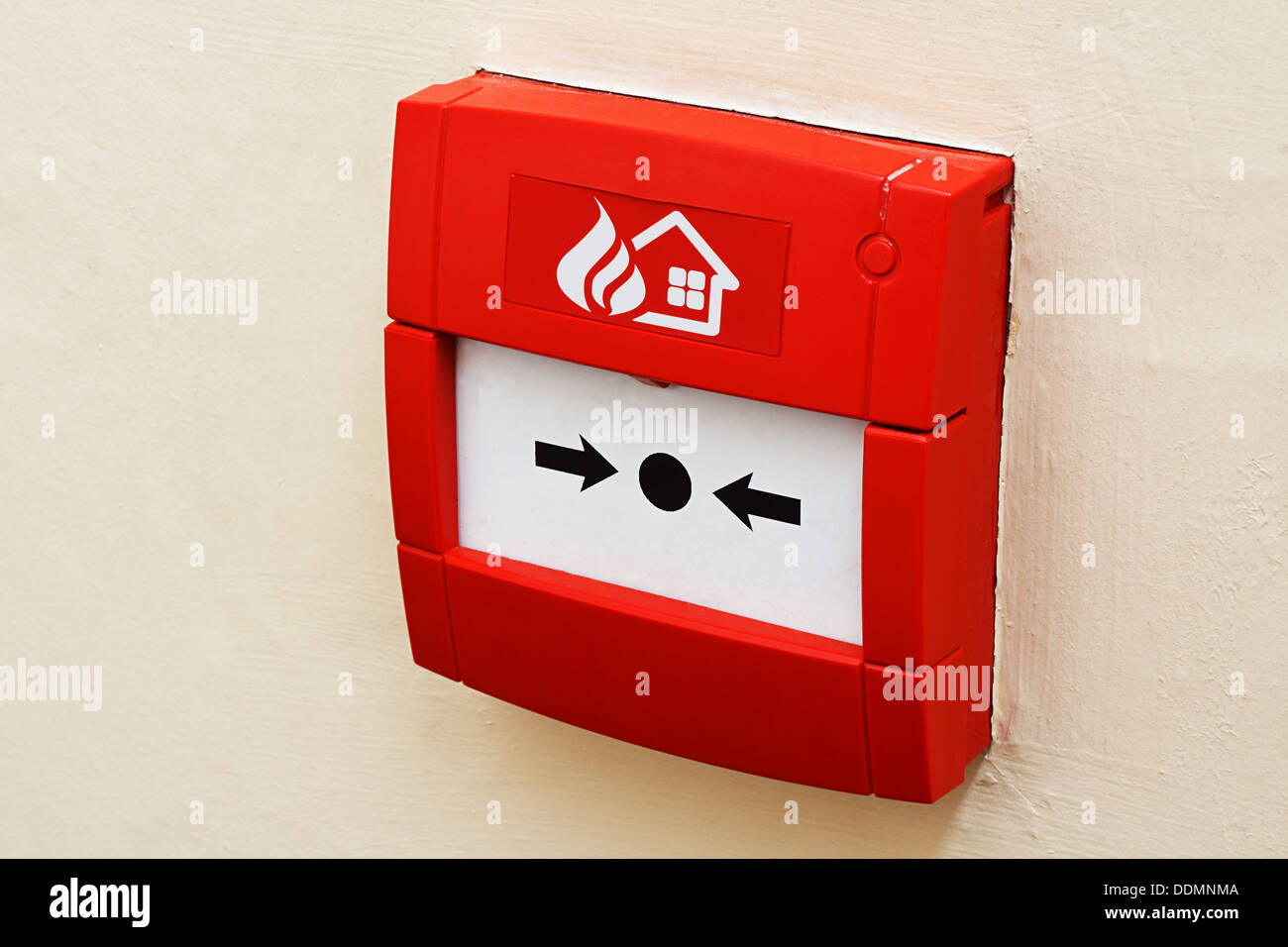 wall mounted Red fire alarm button used to activate warning systems in buildings - Stock Image