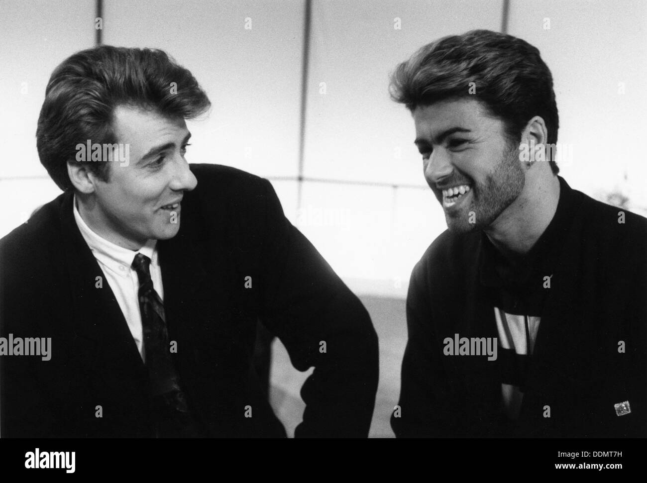 George Michael, British pop singer, and Jonathan Ross, British comedian and TV personality. - Stock Image