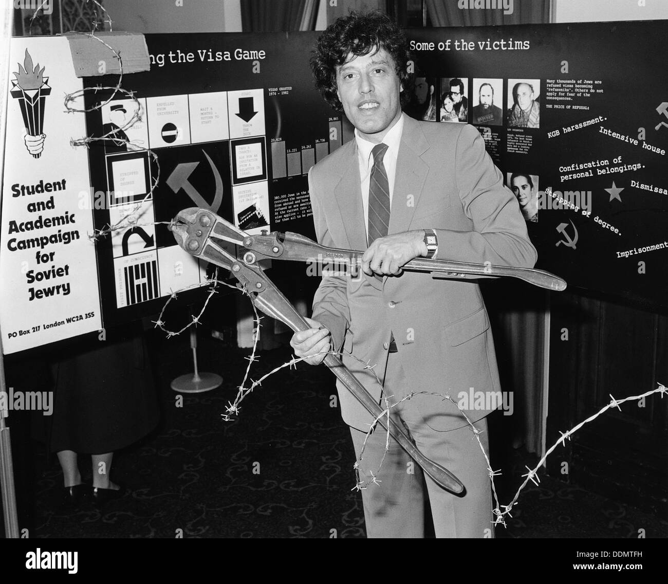 Tom Stoppard (1937-), British Playwright, opening an exhibition for Soviet Jewry. Artist: Sidney Harris Stock Photo