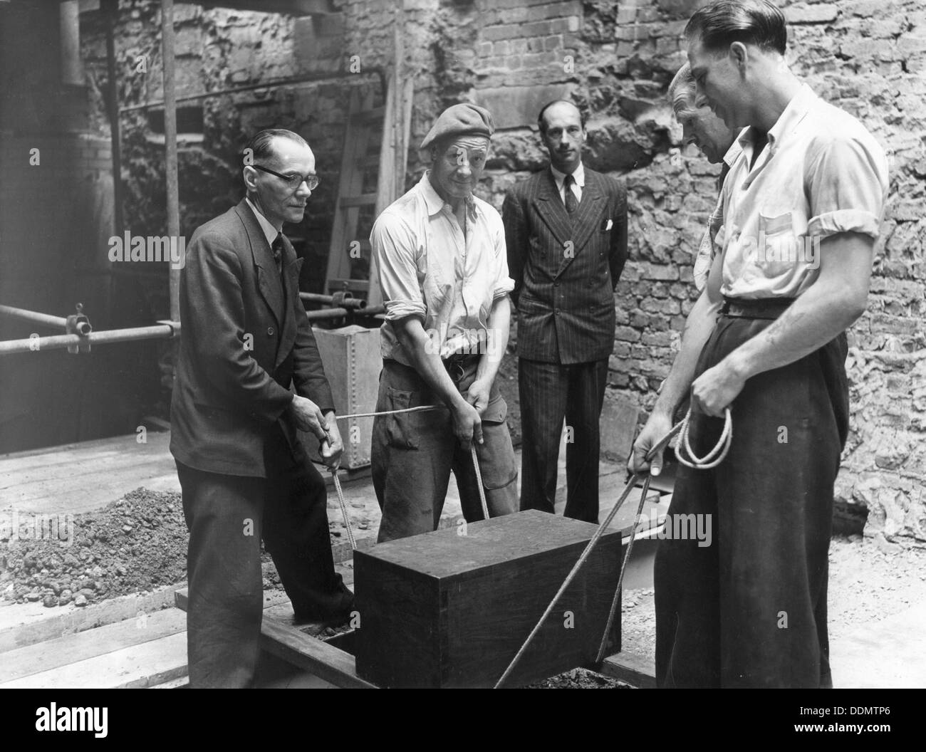 Burying a box containing copies of the Jewish Chronicle, London, 1955. Stock Photo