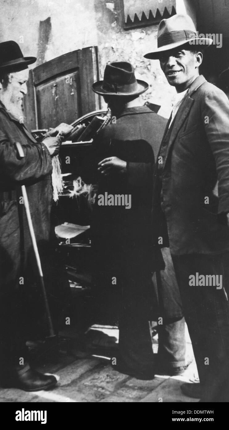 Examining tzitzit, Lemberg Ghetto, USSR, 1941-1944. - Stock Image