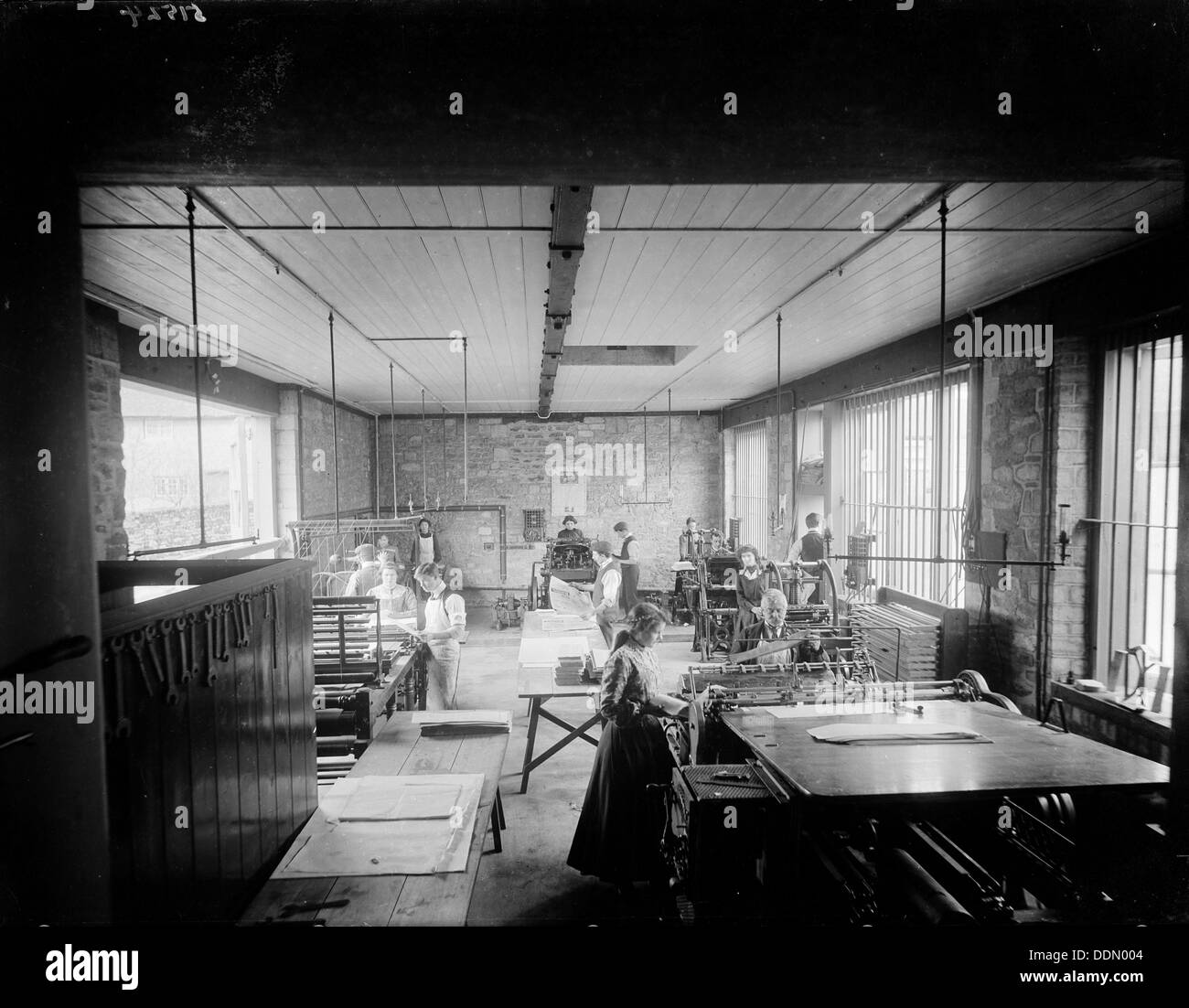 Church Army Press workshop with people at their machines, Oxford, Oxfordshire, c1860-c1922. Artist: Henry Taunt - Stock Image