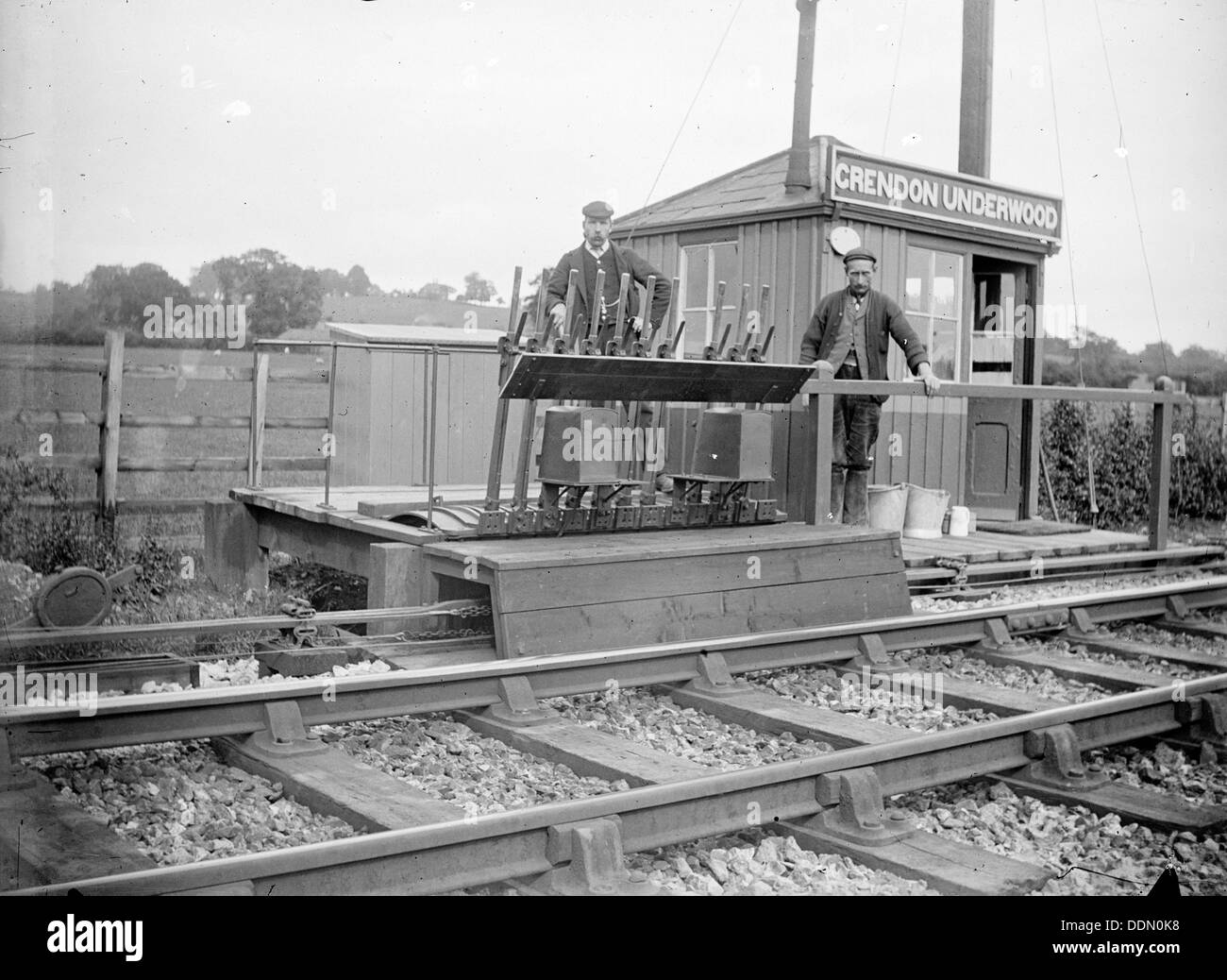 Signalmen pose outside a signal box near Grendon Underwood, Northamptonshire, c1872-c1923. Artist: Alfred Newton & Sons - Stock Image