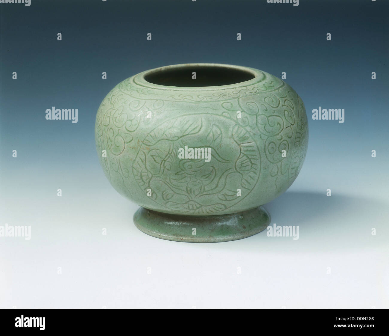 Yue celadon jar with mandarin ducks in lotus medallions, late Tang dynasty, China, 9th-10th century. - Stock Image