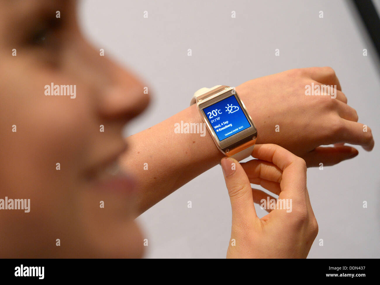 Berlin, Germany. 04th Sep, 2013. Samsung's new 'Galaxy Gear' smartwatch is presented at the consumer electronics fair IFA in Berlin, Germany, 04 September 2013. The IFA takes place from 06 to 11 September, and claims to be the largest consumer electronics fair. Photo: Rainer Jensen/dpa/Alamy Live News - Stock Image
