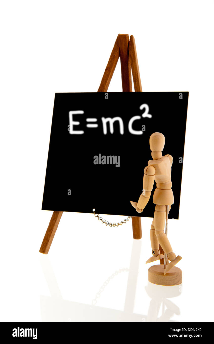 Wooden teacher standing in front of a blackboard on a tripod easel isolated over a white background - Stock Image