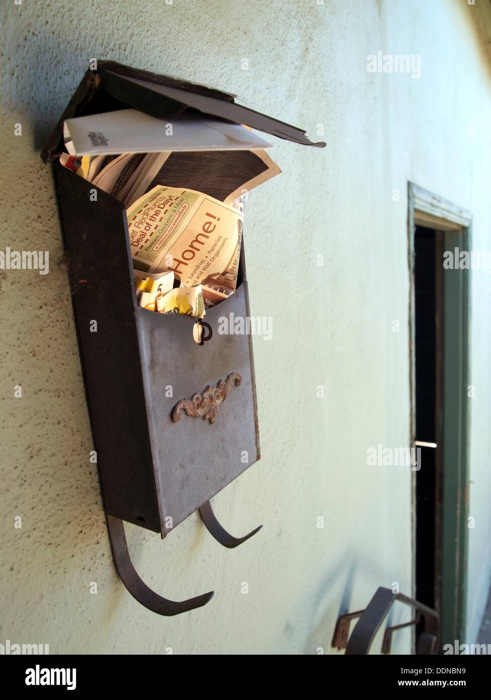 Mail box left behind by the former owners in a foreclosed home in Richmond, California, United States - Stock Image