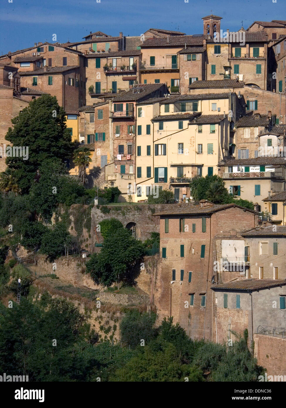 Closely crowded house in the heart of Old Siena, Italy - Stock Image