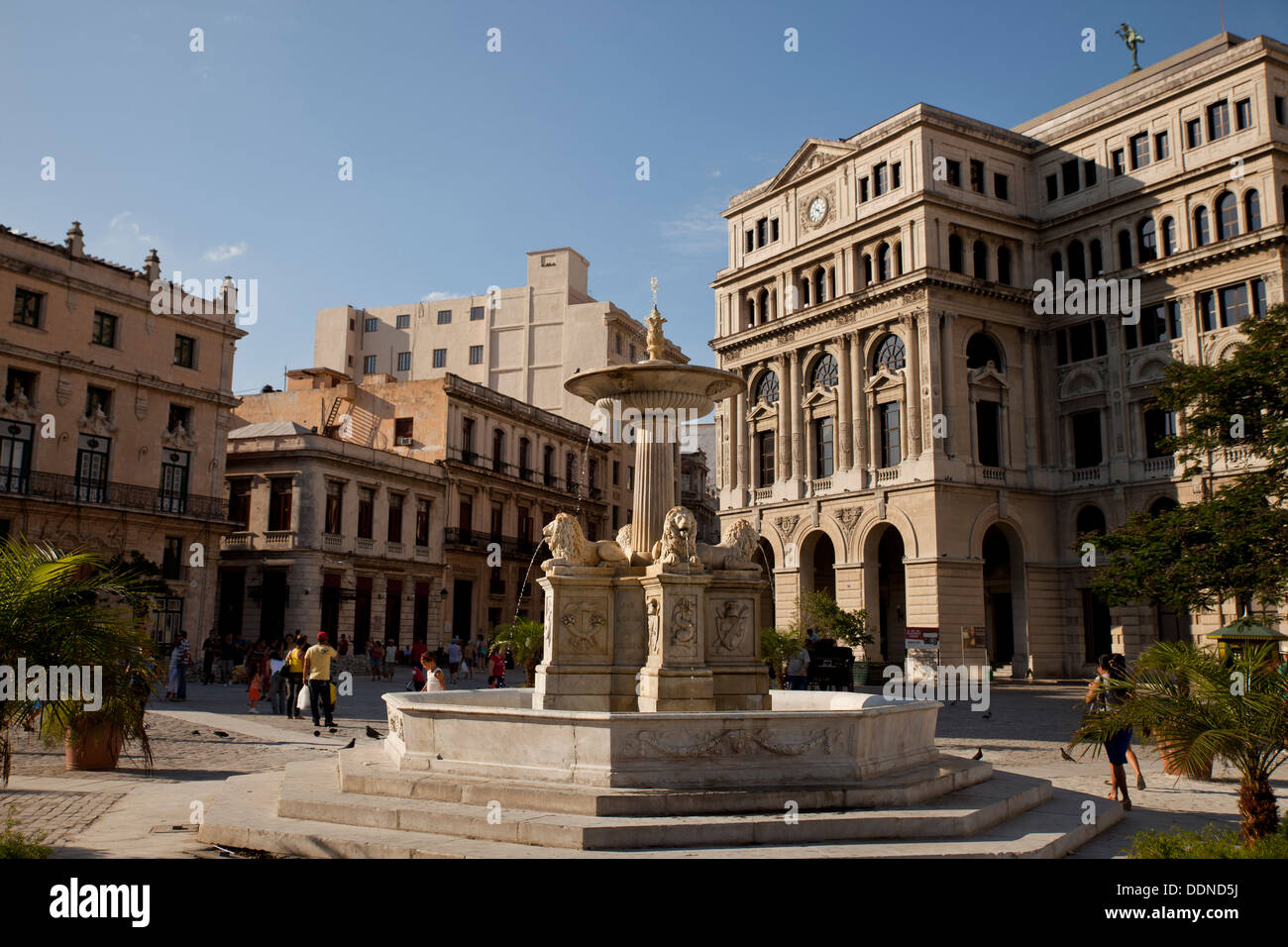marble fountain Fuente de los Leones and Havana Stock Exchange / Lonja del Comercio building on Plaza de San Francisco Stock Photo