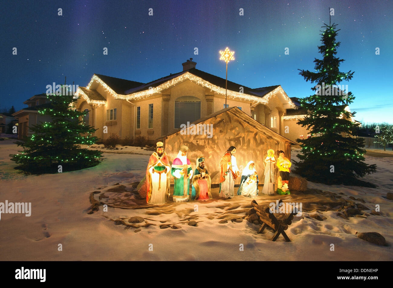 Outdoor christmas nativity scene with northern lights overhead stock outdoor christmas nativity scene with northern lights overhead alberta canada aloadofball Images