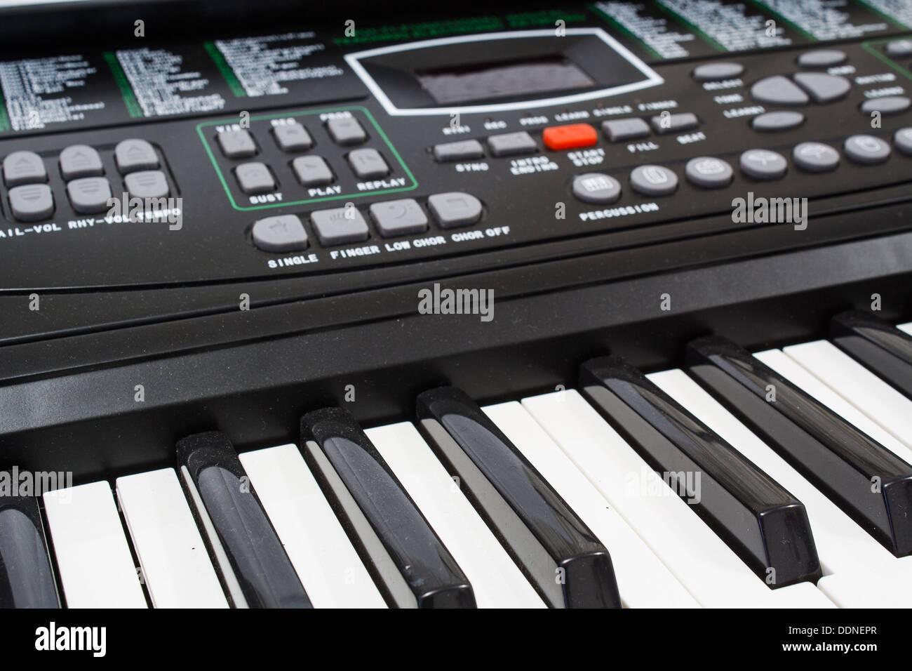 Electric keyboard colur black focus on the keypad. - Stock Image